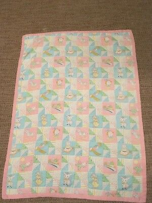 Vintage handmade baby quilt with pink edging