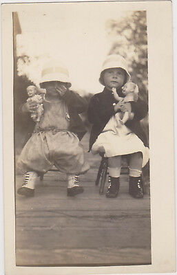 RP; Two Little Girls posing with their dolls, 1900-10s