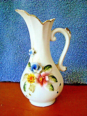 Sweet Miniature Bisque porcelain Pitcher with Raised Floral Design
