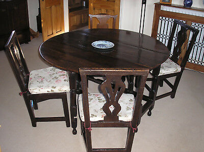 Oak dropleaf table and four chairs