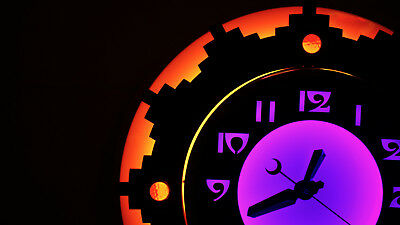 """Curtis, Neon Aztec Clock. 22"""". Orange with. Purple, Red Ruby Jewels."""