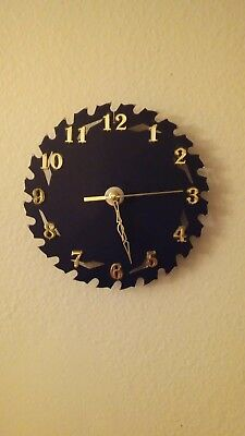 """""""LOOK"""" 7"""" SAW BLADE CLOCK hand crafted blue in color. VERY NICE"""