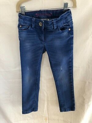 Girls NEXT Blue Wash Jeans with modern rips Size 4yrs Excellent Condition