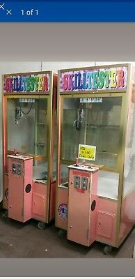 2 coin operated claw machines skill testers