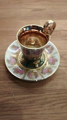 Adler china cup and saucer. Gold and green. Excellent condition