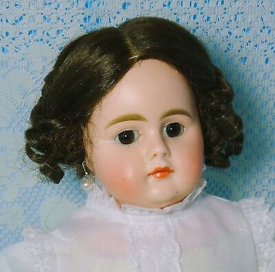 Antique German doll .Bisque head. kid body.Closed mouth.