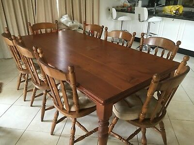 Timber dining table and 8 chairs