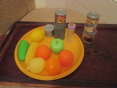 Selection of plastic toy food -oranges,  sweetcorn lemon etc and a doll's bottle
