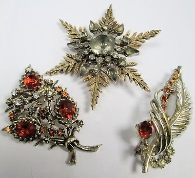 Three good quality vintage brooches (gold metal, diamond paste, amber paste)