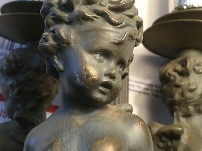 Vintage ornate Cherub brass lamp base with figurines .