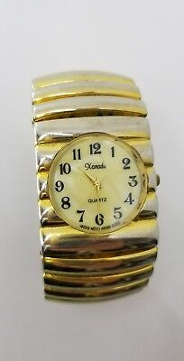 Quartz Watch Mother Of Pearl Face -Hong Kong Mov Metal Gold tone Stretch Band