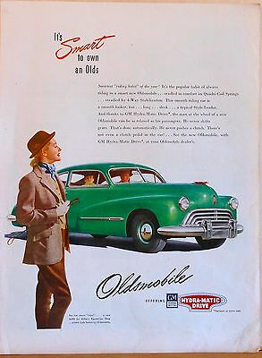1940's magazine ad for Oldsmobile - Woman in riding habit & green Club Sedan