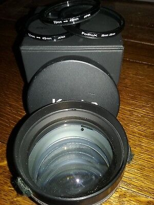 Kenko VC-200Hi 2.0x Video Tele Converter Lens with adapter rings and case.