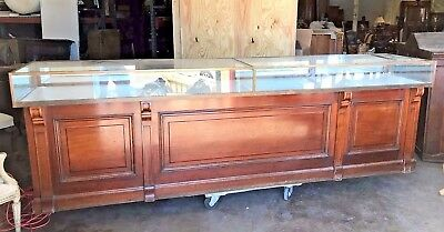 Large American mahogany and glass jewelry display case.