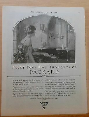 1923 magazine ad for Packard - art by Fred Mizen, woman admiring auto in mirror