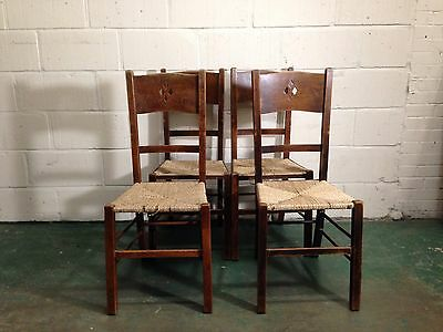 A SET OF FOUR ARTS AND CRAFTS OAK SIDE CHAIRS c1900s