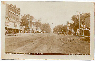 Real Photo Postcard Main Street looking North in Garden City, Kansas~105961