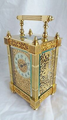 Antique French 19th C brass carriage clock with filigree decoration