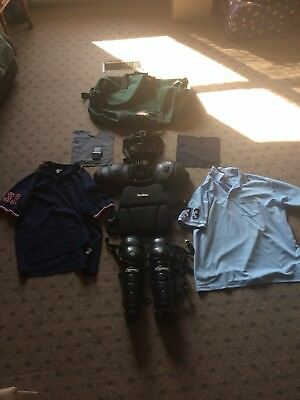 umpire equipment chest protector leg guards mask duffle bag and 2 shirts