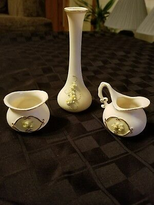 Small Sugar, Creamer, and bud vase. signed M. Mickelson