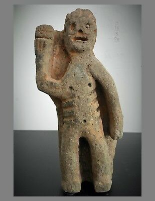 Prehistoric 11 inch pumice stone Hawaiian figure, holding kahili feather wand