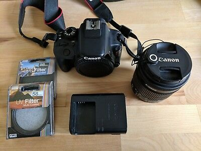 Canon EOS Rebel SL1 / EOS 100D 18.0MP Digital SLR Camera - Black + 2 Filters