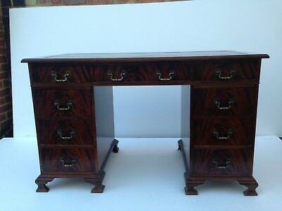 A George The Third Style Mahogany Nine Draw Pedestal Desk With Green Leather Top