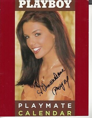 PMOY 04  Carmella DeCeasere Autographed Playmate Calendar cover! So pretty!