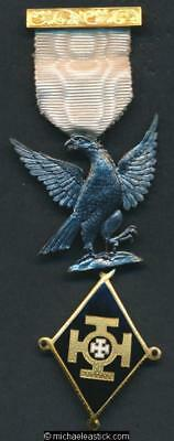 Masonic badge: grey eagle gold, black and white enamel diamond and white ribbon