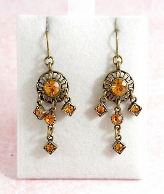 Vintage style brassy metal drop earrings with yellow stones