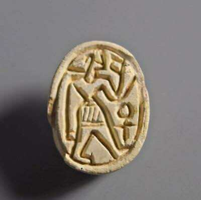 Egyptian scarab with kilted warrior: Circa 1600 BC.