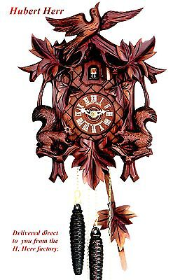 Hubert Herr,  Black Forest lovely deep carved 1 Day weight driven cuckoo clock.