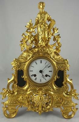 Antique French Empire early 1800's gilt ormolu bronze mantle clock by Henri Marc