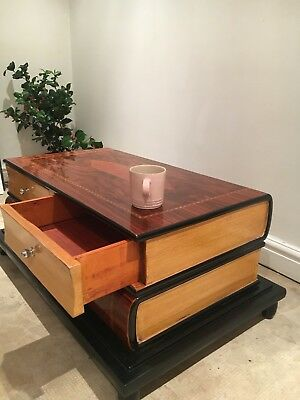 An Italian Style Rosewood Effect Book Shaped Coffee Table Includes