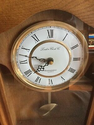 london pendulum wall clock oak case.. with Westminster chimes  battery operated.