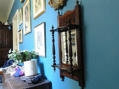 mahogany mirror with two shelfs and twiddly bits
