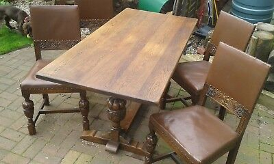 Oak Hard Wood Table and 4 Oak Chairs.