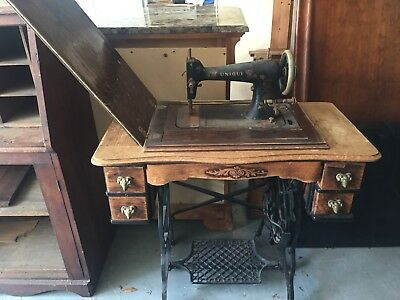 Antique Sewing Machine in Oak Cabinet