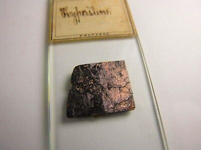 Antique Microscope Slide by Norman. Mineral. Hyperstine. Uncovered specimen.