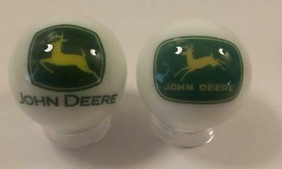 A Lot of 2 John Deere Tractor Logos Advertising Glass Marbles
