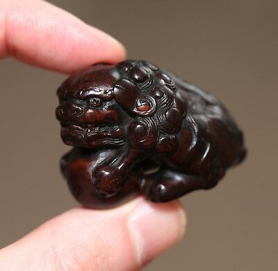 antique Japanese carved boxwood netsuke of a ShiShi, Meiji, 19th century, SUPERB