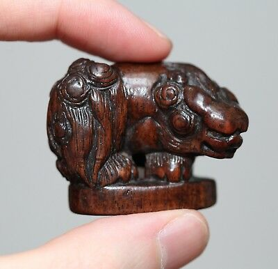 antique Japanese carved boxwood netsuke of a ShiShi, Meiji, 19th C, Very FINE.