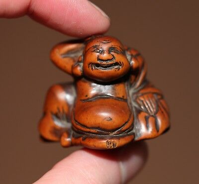 antique Japanese carved boxwood Netsuke of Hotei, 18th century, Edo period. RARE