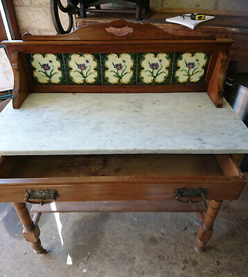 Vintage / Antique wash stand with marble top on wheels.