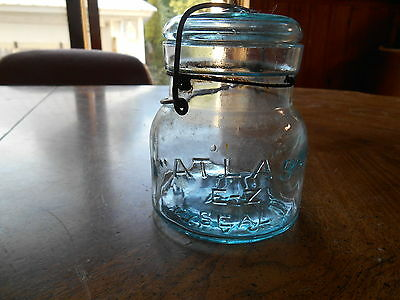 "Antique glass hard to find blue greenish  ""Atlas"" e-z seal squaty pint jar"