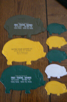 Lot 8 Pocket Pigs Plastic Coin Holder 1960's State Bank of Arnold Advertising