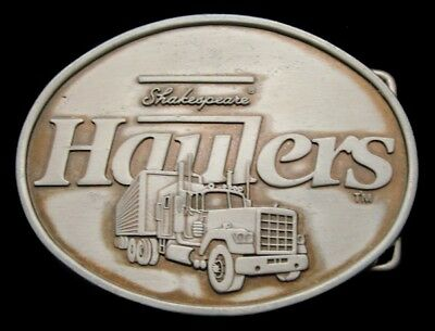 PA02104 VINTAGE 1980s **HAULERS** SHAKESPEARE FISHING RODS TRUCKING BUCKLE