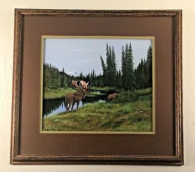 Gorgeous mountainscape depicting a moose and a lake.  Signed Weaver. Dated 1974