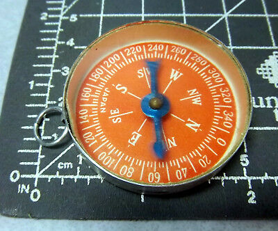 vintage 1960 kids dime store toy, metal and glass Compass, made in Japan, red