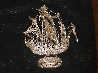 filigree model of a ship maybe silver ?